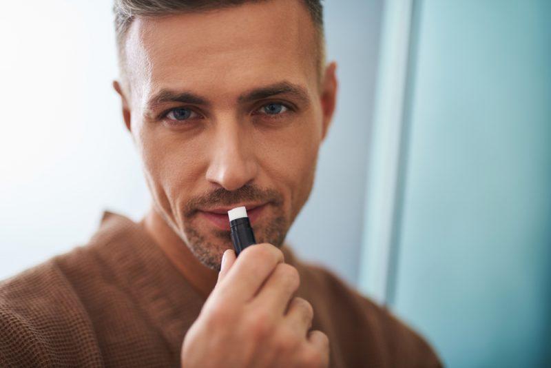 Man Putting on Lip Balm