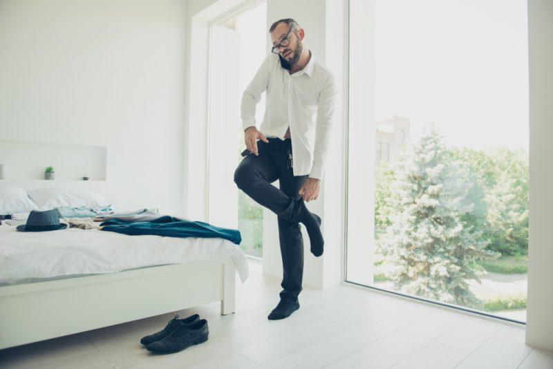 Man Putting on Socks