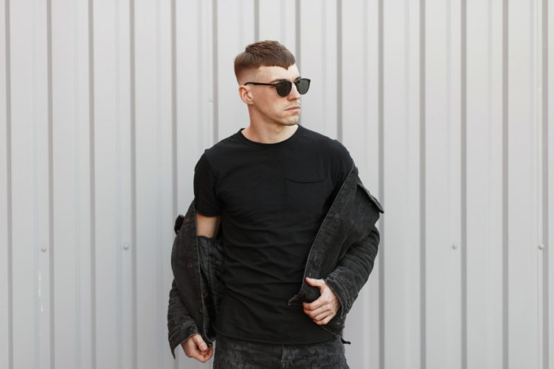 Man in T-Shirt Sunglasses and denim Jacket