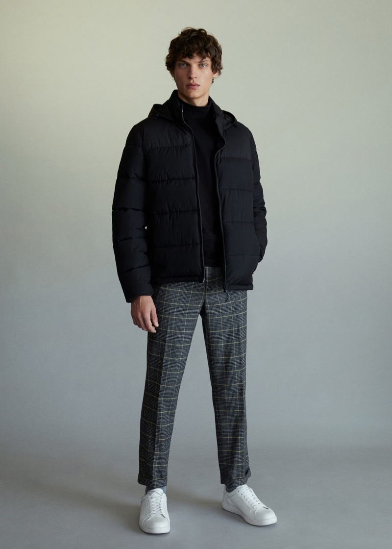 Taking to the studio, Valentin Caron models a look from Mango's latest arrivals.