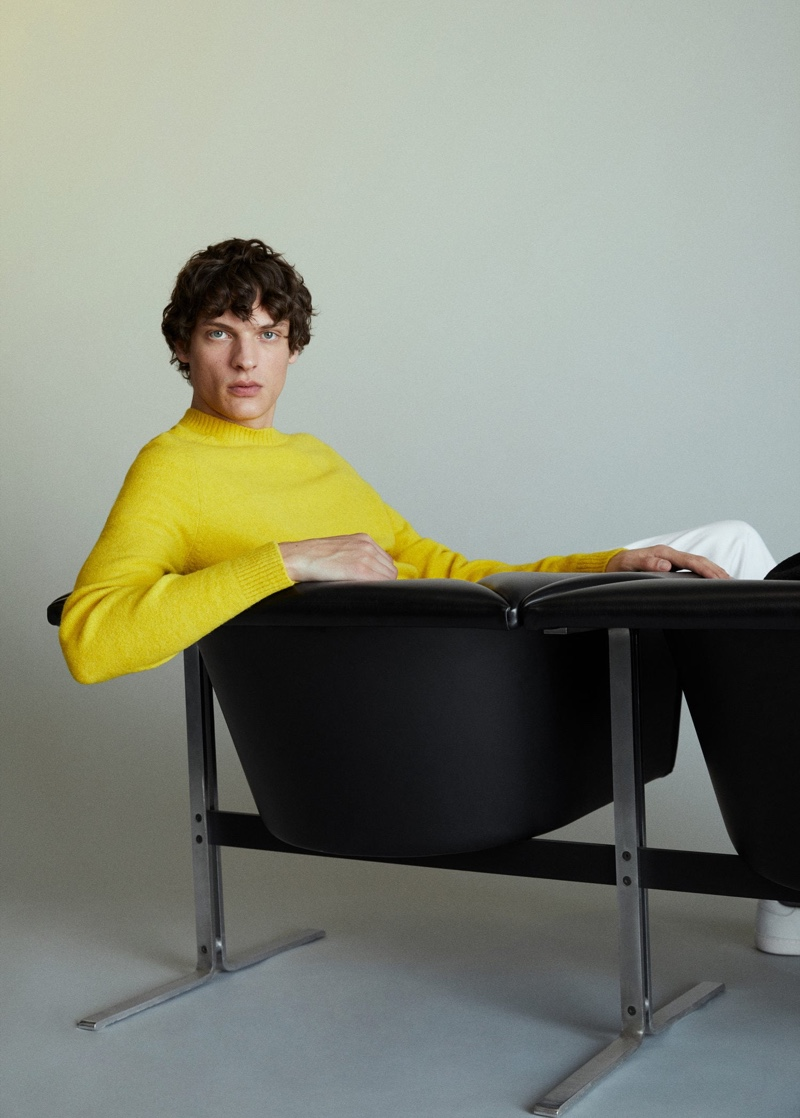 Making a splash in yellow, Valentin Caron wears a Mango sweater.