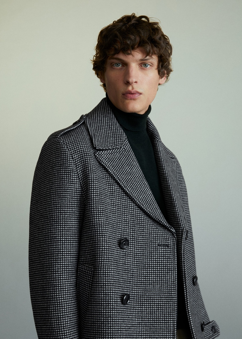 An elegant vision, Valentin Caron dons a double-breasted coat from Mango.