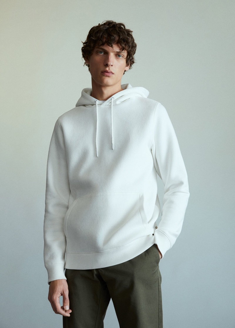 Sporting essentials from Mango, Valentin Caron wears must-haves like the hoodie.