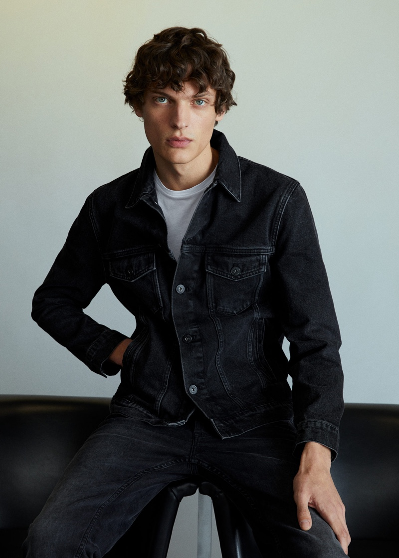 Clad in black denim, Valentin Caron sports Mango.