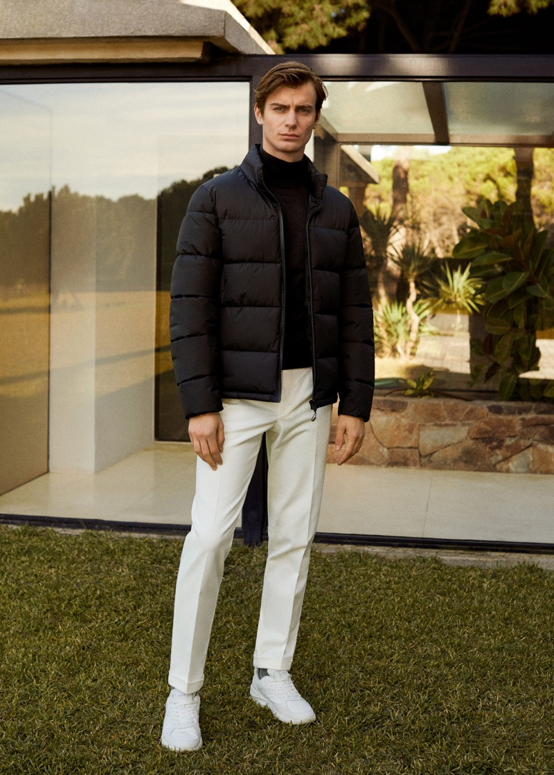 Ben Allen sports a black puffer jacket with pleated pants by Mango.
