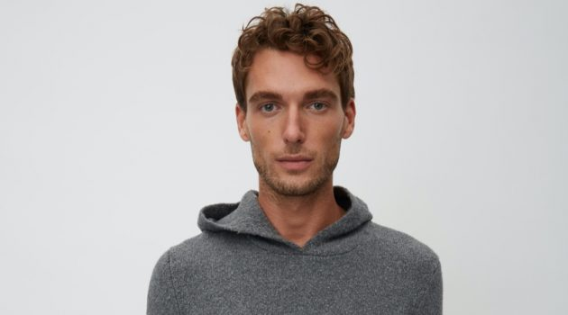 Nikola Jovanovic wears a grey hooded knit from Marc O'Polo's Christmas collection.