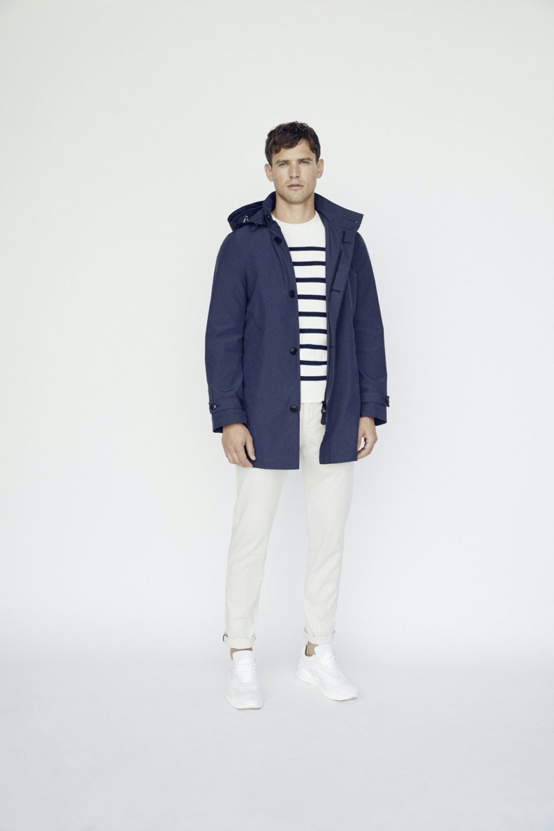 Embracing nautical style from Marc O'Polo, Guy Robinson wears a Breton striped  sweater with a navy parka.