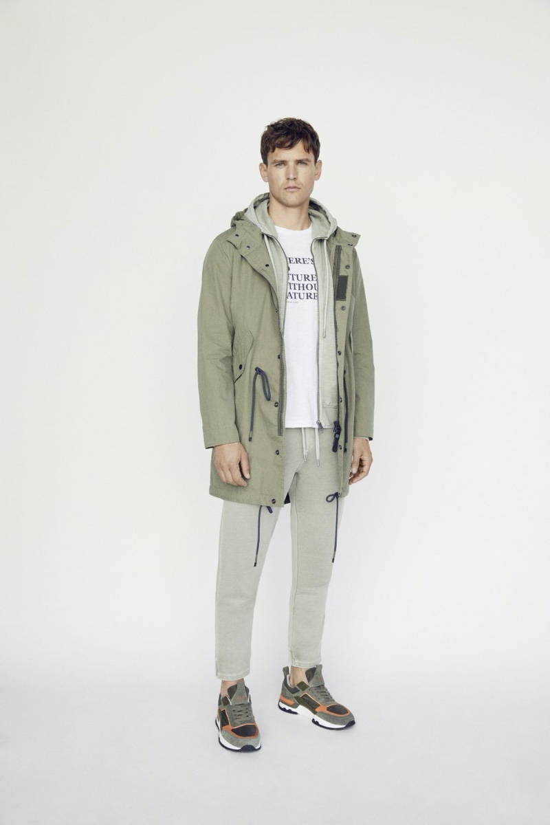 Donning neutrals, Guy Robinson layers in a hoodie and parka from Marc O'Polo.