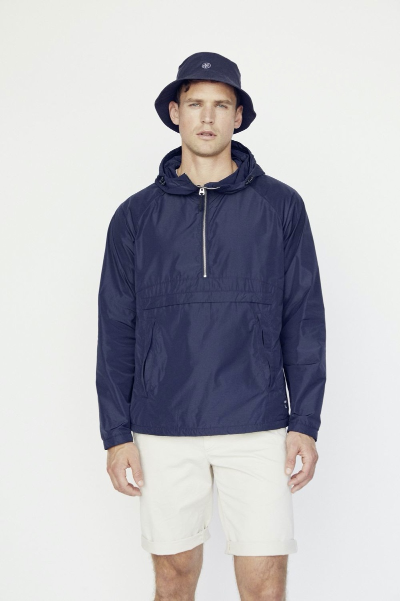 British model Guy Robinson sports a windbreaker with shorts and a bucket hat from Marc O'Polo.