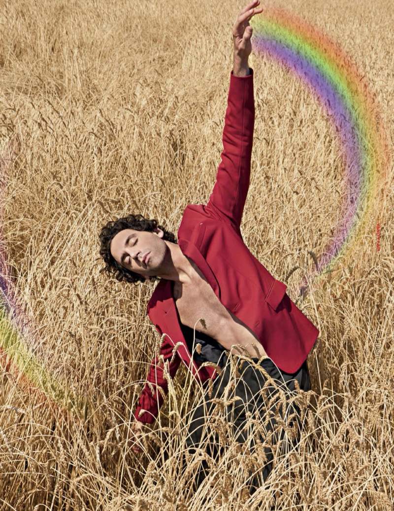 Taking to a field with Vanity Fair Italia, Mika sports a Berluti suit jacket with vintage pants.