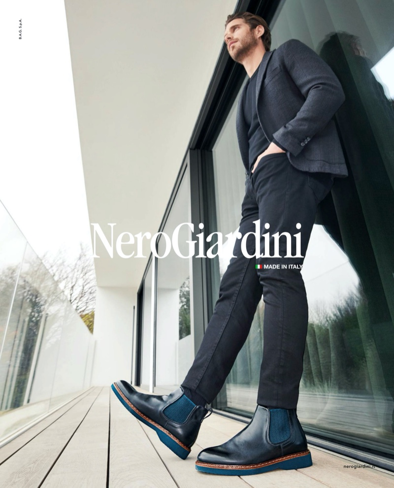 A sleek vision, Simone Bredariol wears black and blue boots for Nero Giardini's fall-winter 2019 campaign.