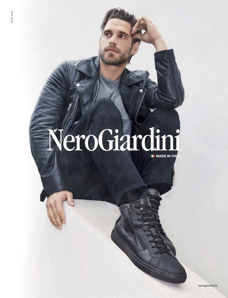 Simone Bredariol rocks black sneakers for Nero Giardini's fall-winter 2019 campaign.