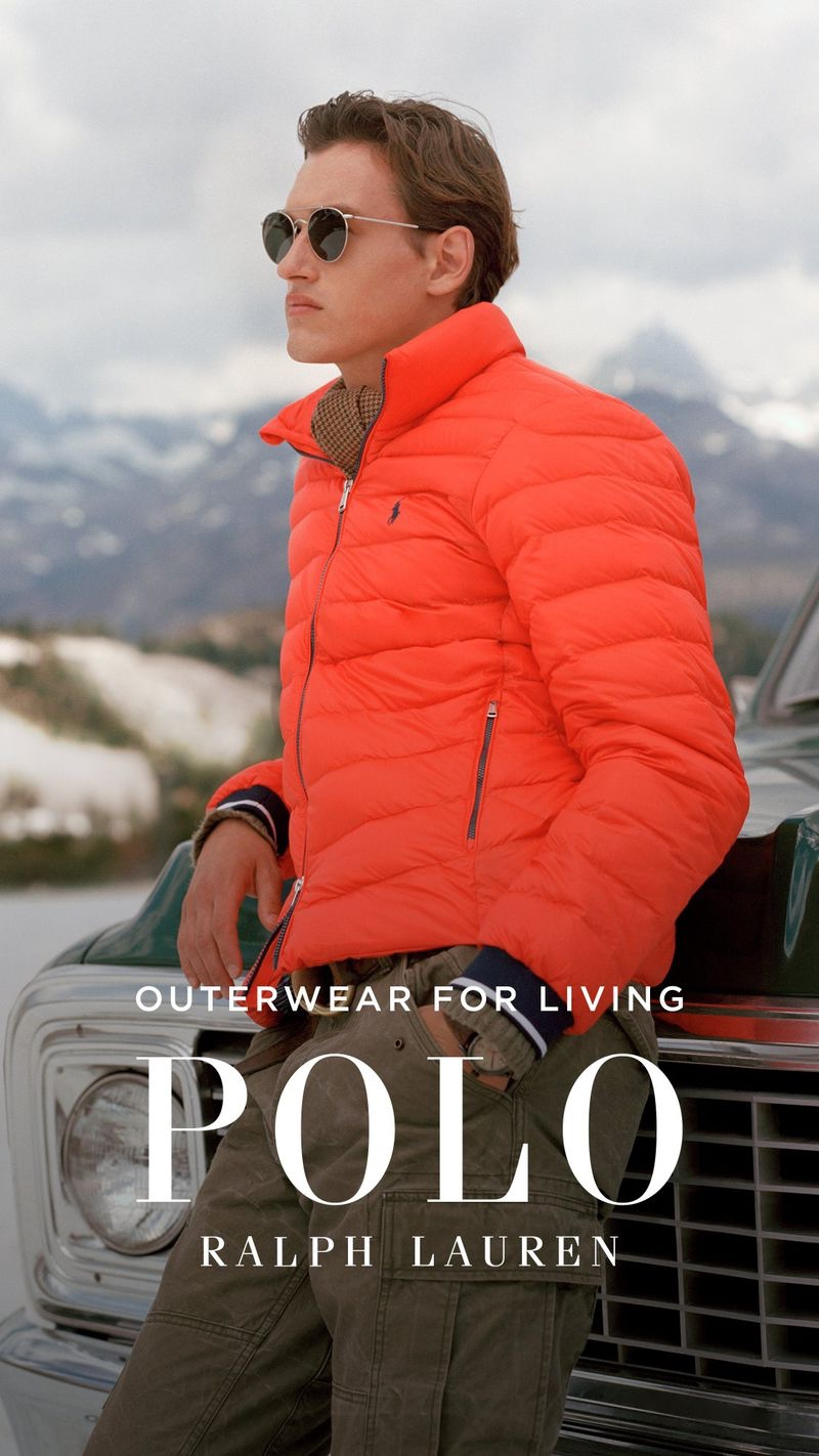 Sporting a orange quilted jacket, Jegor Venned stars in POLO Ralph Lauren's fall-winter 2019 outerwear campaign.