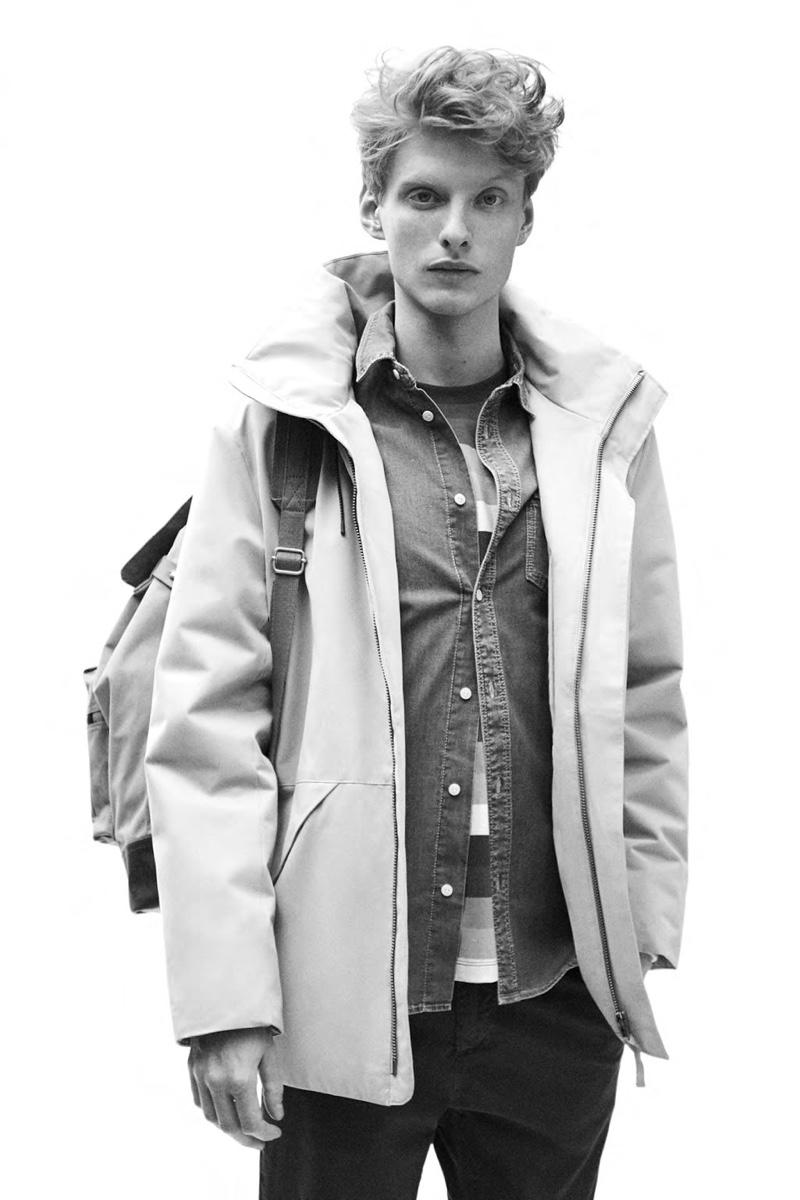 Sporting a hooded jacket, Iwan Zalewski models a look from Pepe Jeans.