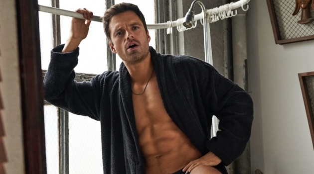 Ready for an ice bath, Sebastian Stan sports a robe and bathing suit by Emporio Armani with a David Yurman necklace.
