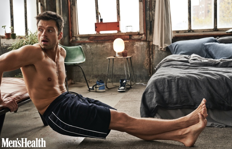Connecting with Men's Health, Sebastian Stan wears Armani Exchange shorts with a Tiffany & Co. necklace and Nike Air Jordan sneakers.