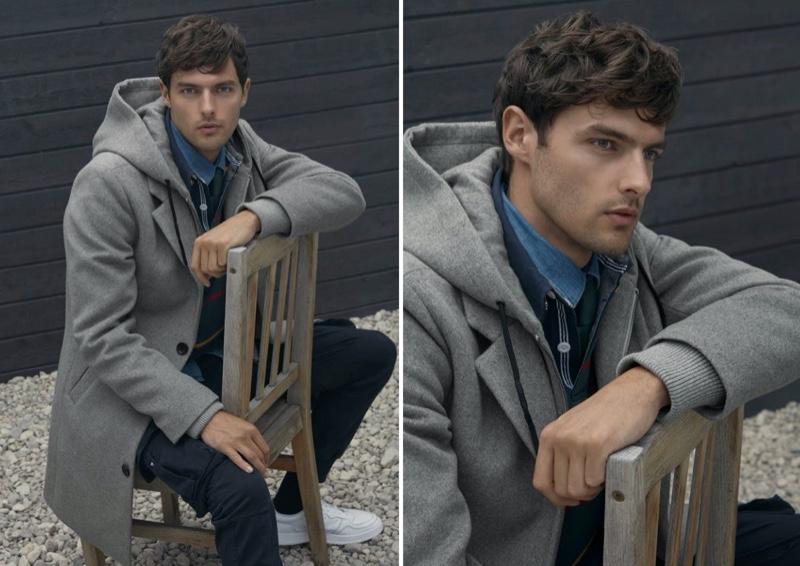 Model Hannes Gobeyn sports a LE 31 hooded overcoat in grey.