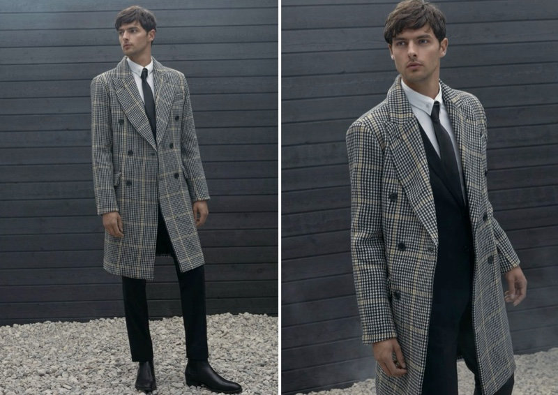 Embracing a sophisticated look, Hannes Gobeyn wears a LE 31 accent line houndstooth overcoat.