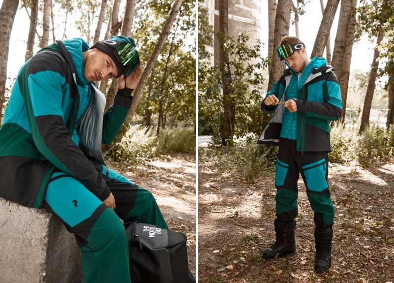 Front and center, Matthew Noszka wears a aqua-colored coat and snow pants from Peak Performance.