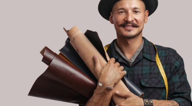 Smiling Man Holding Leather Hat Mustache