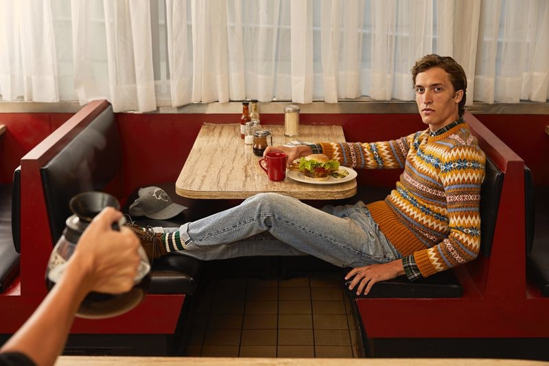 Tim Dibble wears a Todd Snyder wool fairisle sweater $298 with a tartan holiday plaid shirt $168 and denim jeans.