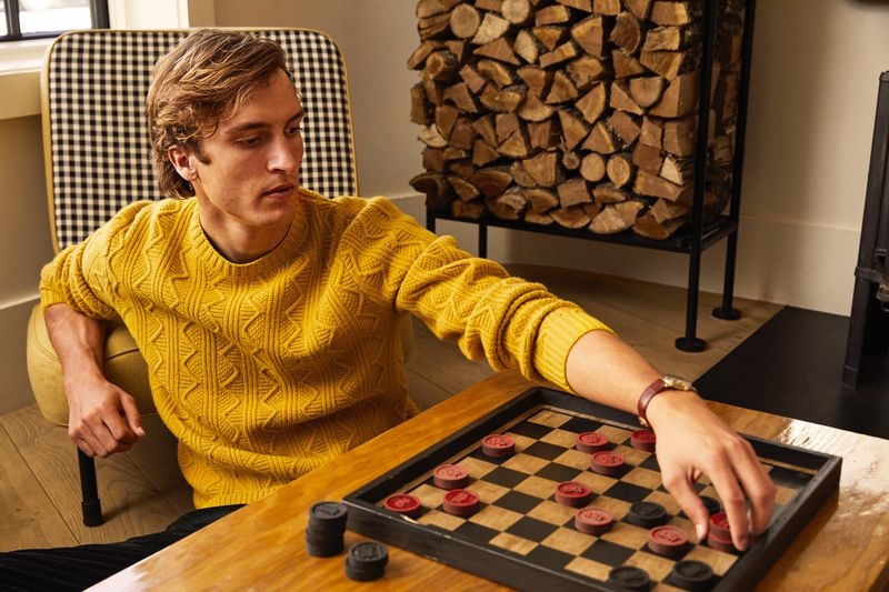 Making a case for color, Tim Dibble dons a yellow merino cable-knit sweater $278 from Todd Snyder.