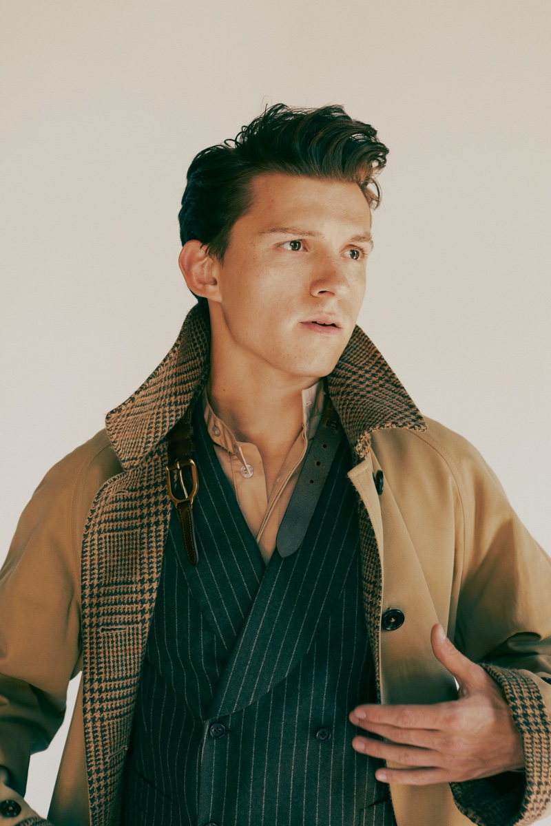 Front and center, Tom Holland sports a Ralph Lauren coat with a ISAIA vest and Rochas shirt for GQ Style USA.