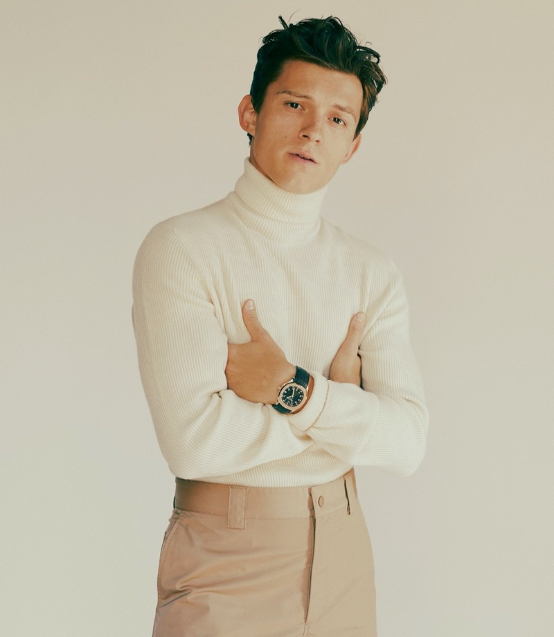 Actor Tom Holland wears a Brunello Cucinelli turtleneck and Valentino pants with his own Patek Philippe watch for GQ Style USA.