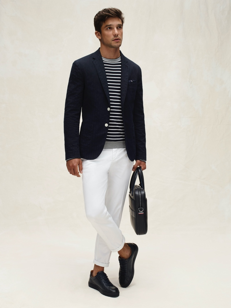 Alexis Petit makes a case for sophisticated nautical style in a striped top and blazer from Tommy Hilfiger's spring-summer 2020 collection.