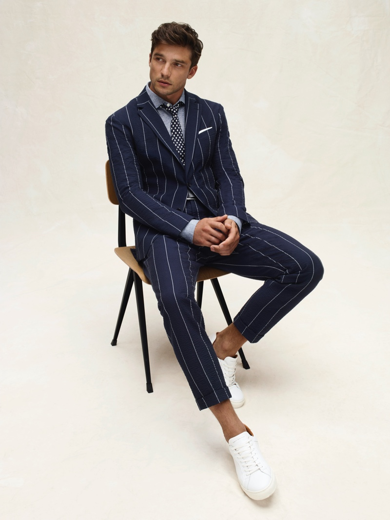 French model Alexis Petit dons a pinstriped suit from Tommy Hilfiger's spring-summer 2020 collection.