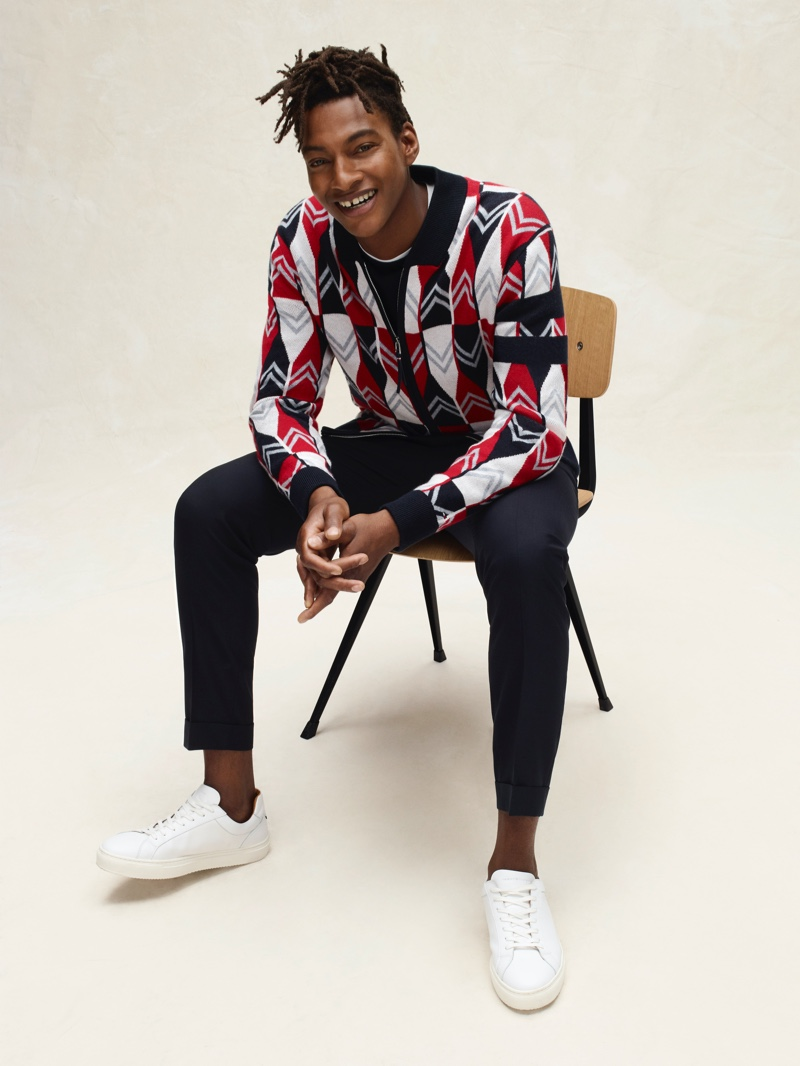 Ty Ogunkoya dons a half-zip graphic pullover from Tommy Hilfiger's spring-summer 2020 collection.