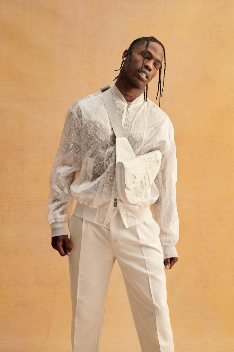 Dressed in white, Travis Scott sports Dior Men.