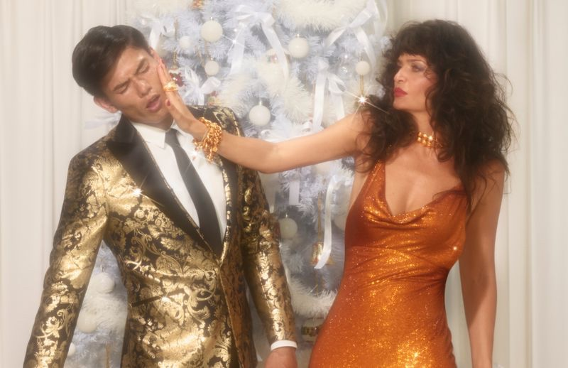 Slapping Simonas Pham, Helena Christensen makes an appearance in Versace's holiday 2019 campaign.