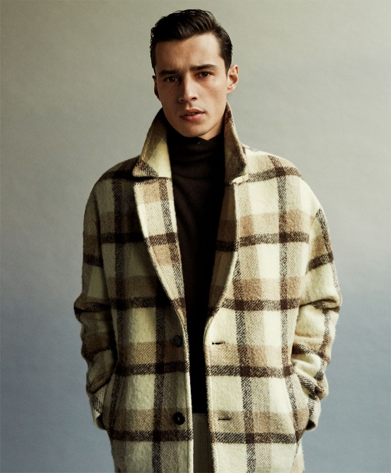 Front and center, Adrien Sahores dons a checked coat from Zara.