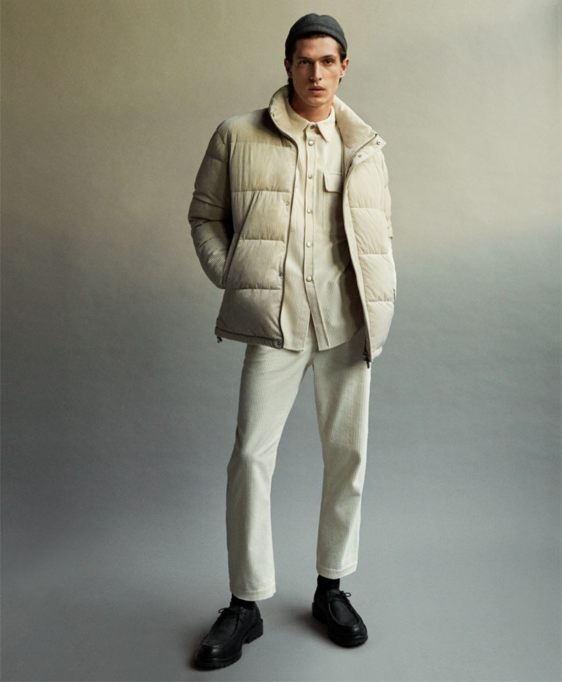 Embracing a neutral color palette, Edoardo Sebastianelli rocks a matching corduroy shirt and pants with a puffer jacket by Zara.