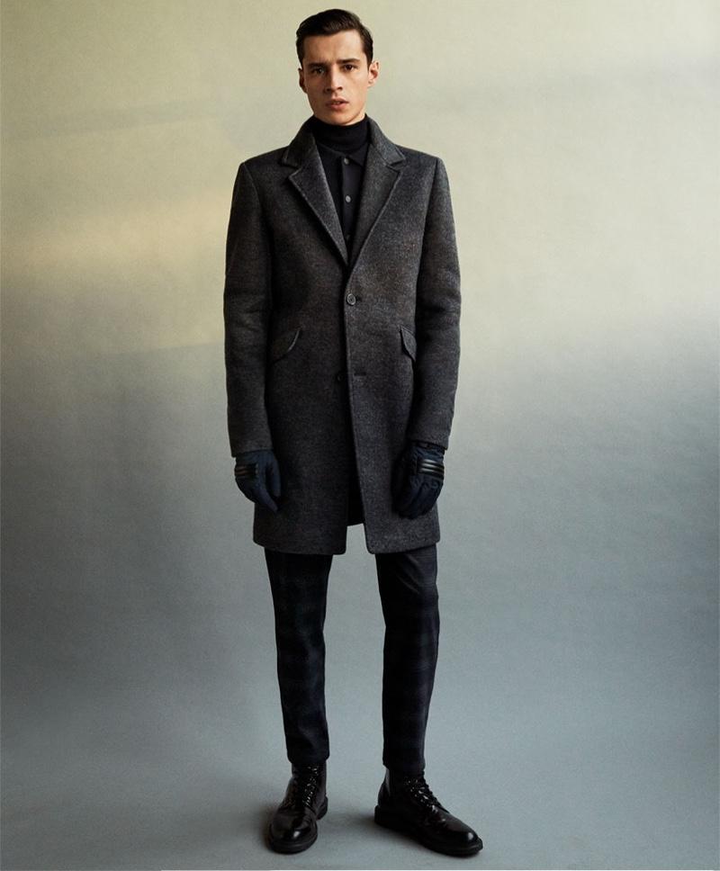 Taking to the studio, Adrien Sahores wears a dark fall-winter 2019 look from Zara.