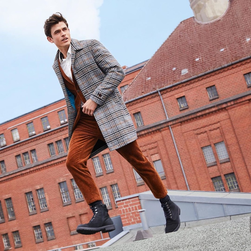 On the move, Luc van Geffen dons smart style from s.Oliver Black Label.