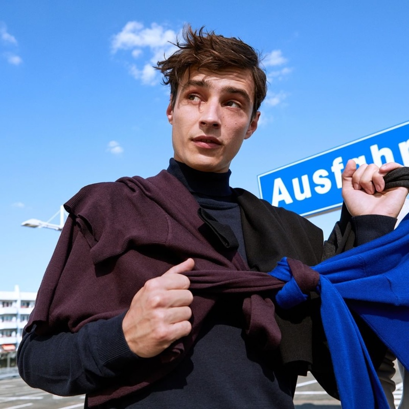 French model Adrien Sahores ties together a look from s.Oliver.