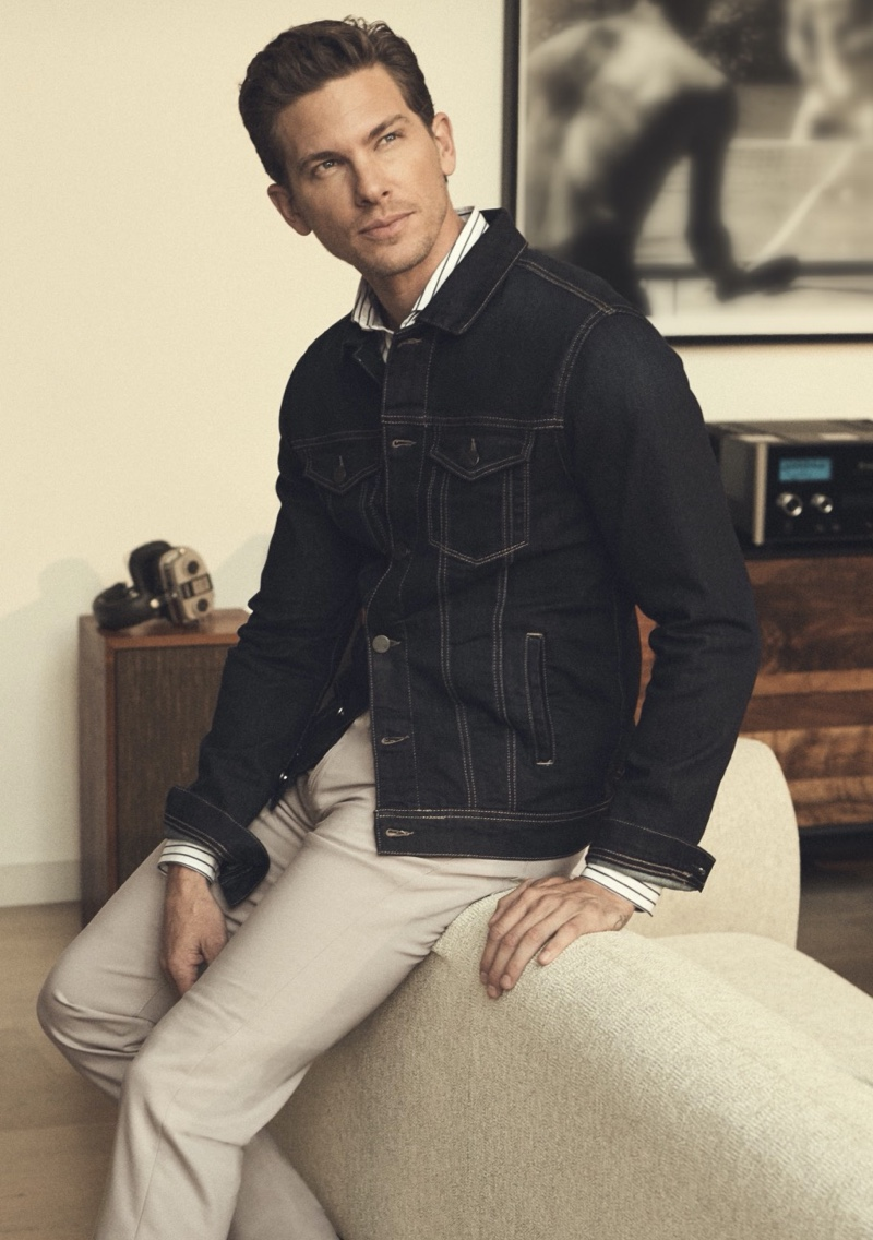 Adam Senn models 34 Heritage's Travis denim jacket and Charisma comfort-rise, classic fit pants.