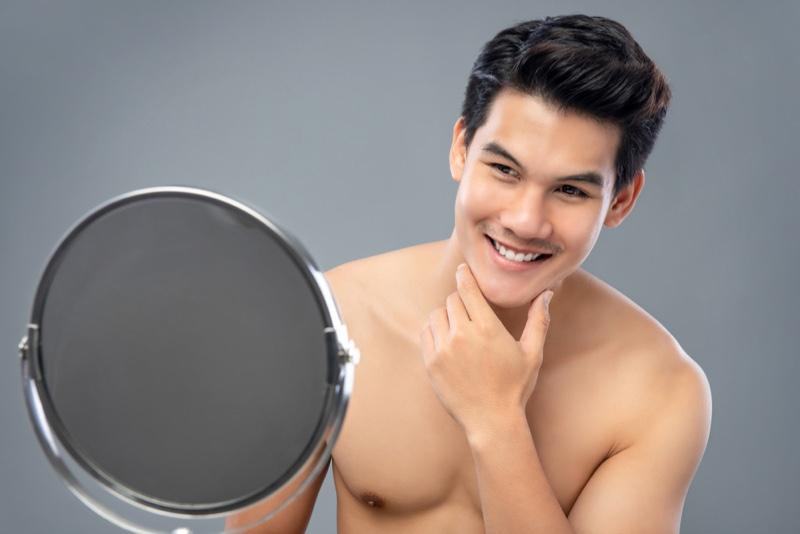 Asian Man Smiling Mirror Clear Skin