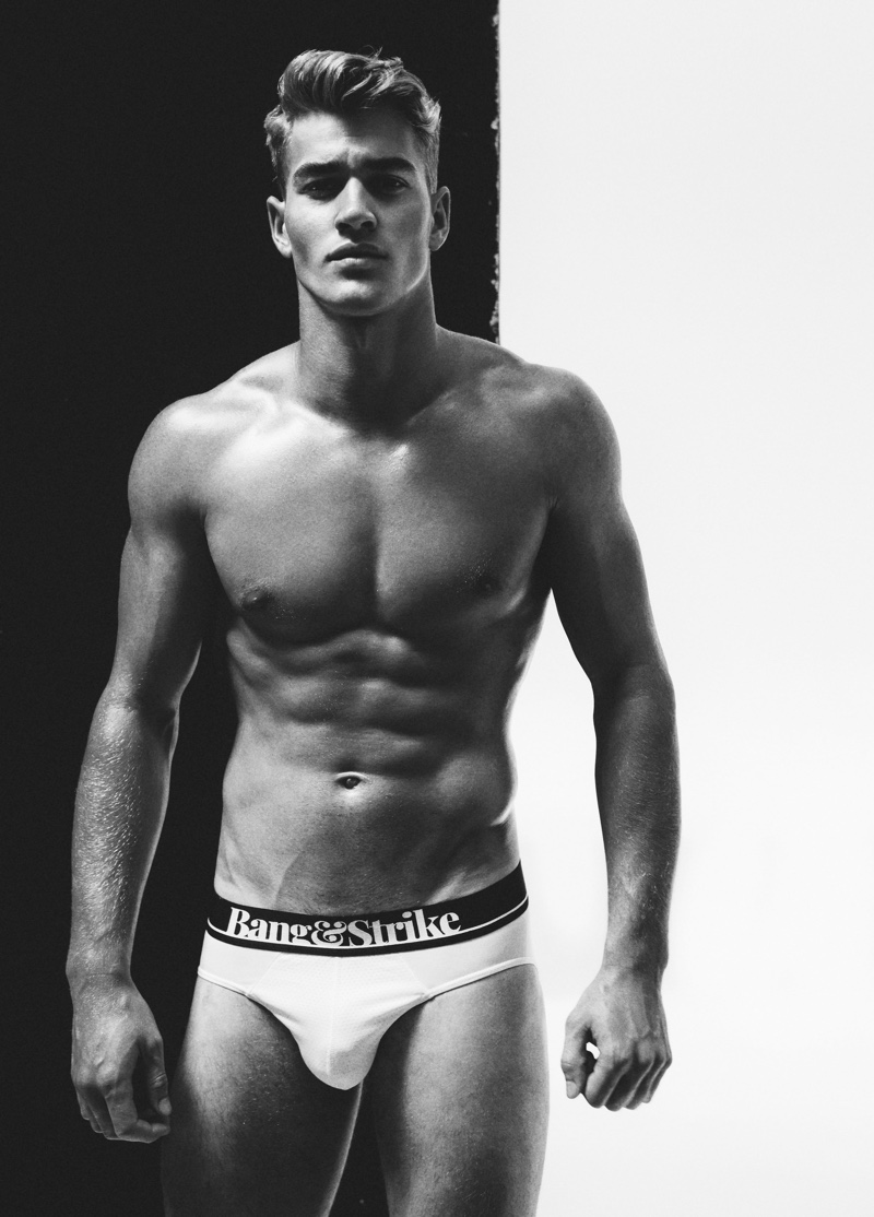 Appearing in a black and white photo, Matty Carrington models Bang & Strike flex sport underwear.