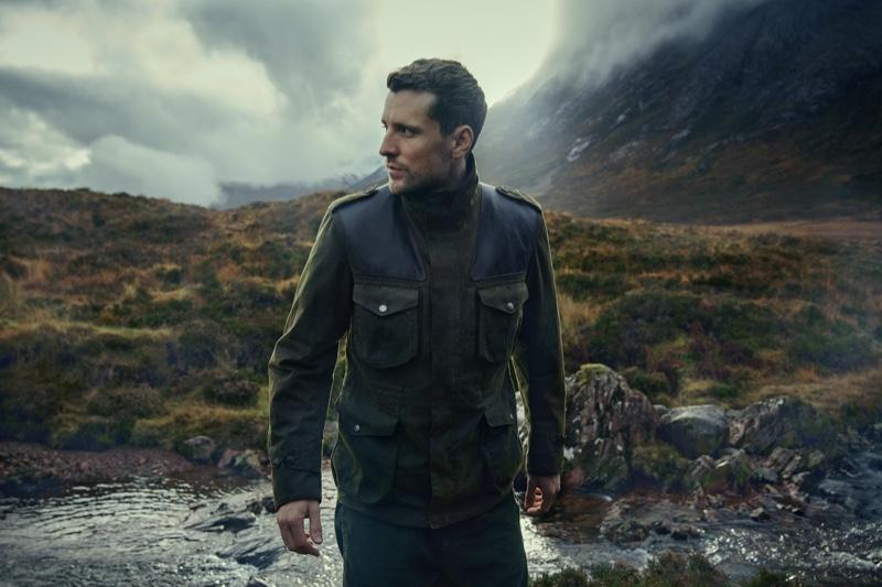 Embracing military-inspired style, George Barnett rocks a Barbour Gold Standard Supa Corbridge Wax jacket.