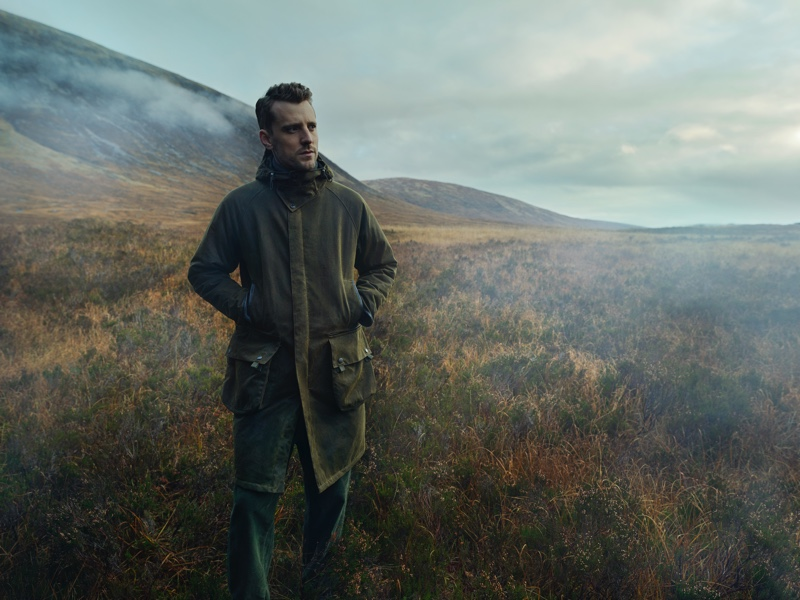 Pictured outdoors, George Barnett models a Barbour Gold Standard Supa-Hunting Wax jacket.