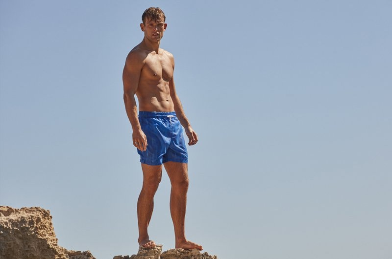 Traveling to Italy, Elliott Reeder wears a pair of Derek Rose's swim shorts.