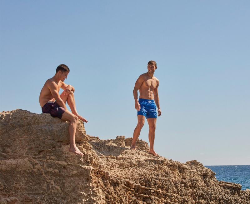 Venturing outdoors, William Goodge and Elliott Reeder model swimwear from Derek Rose.