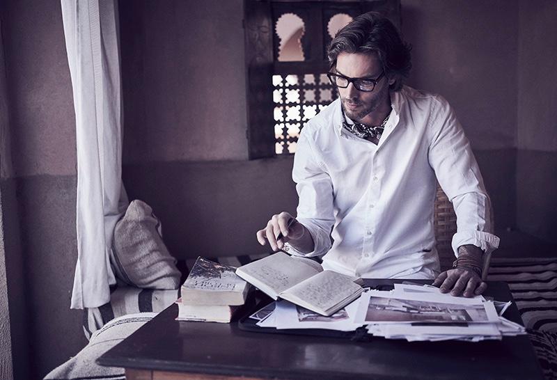 Donny wears glasses Yves Saint Laurent, shirt Canali, scarf and leather bracelet Hermès.