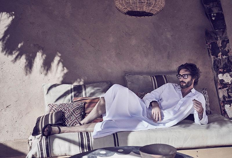 Donny wears kaftan Billionaire Dubai, glasses Cutler & Gross, leather bracelet Hermès, and sandals Yves Saint Laurent.