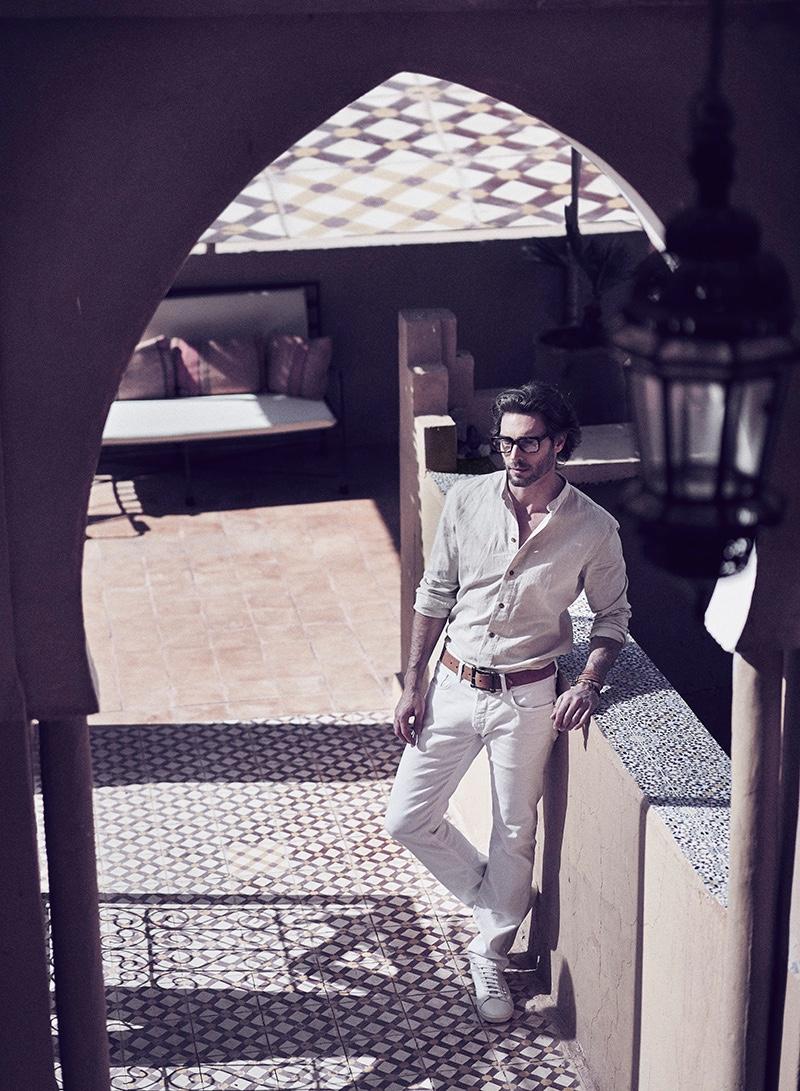 Donny wears pants Zegna, shirt YOOX, sneakers Superga, glasses Cutler & Gross, belt Vintage Love, and bracelet Hermès.