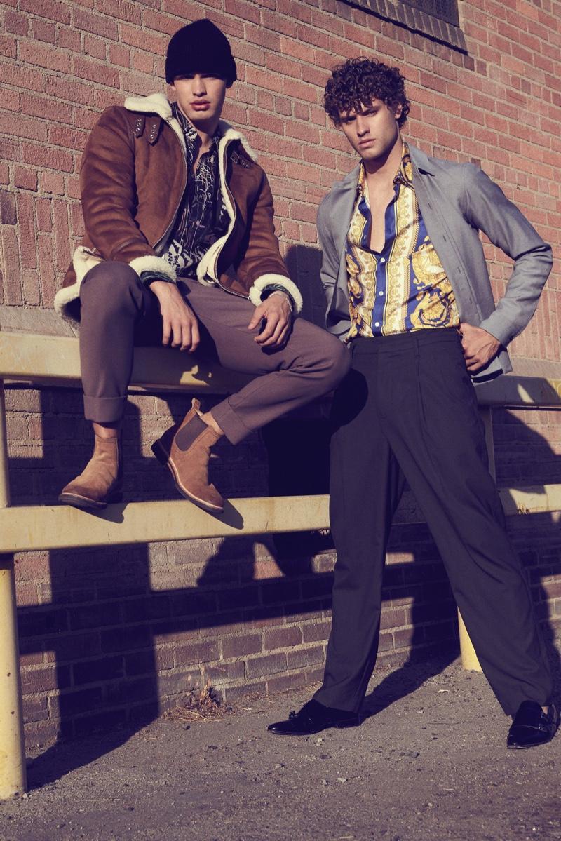 Left: Ben wears jacket H&M, boots Jimmy Choo, shirt and pants 3.1 Phillip Lim. Right: Dean wears shirt Versace, shoes Cesare Paciotti, pants and jacket Jil Sander.