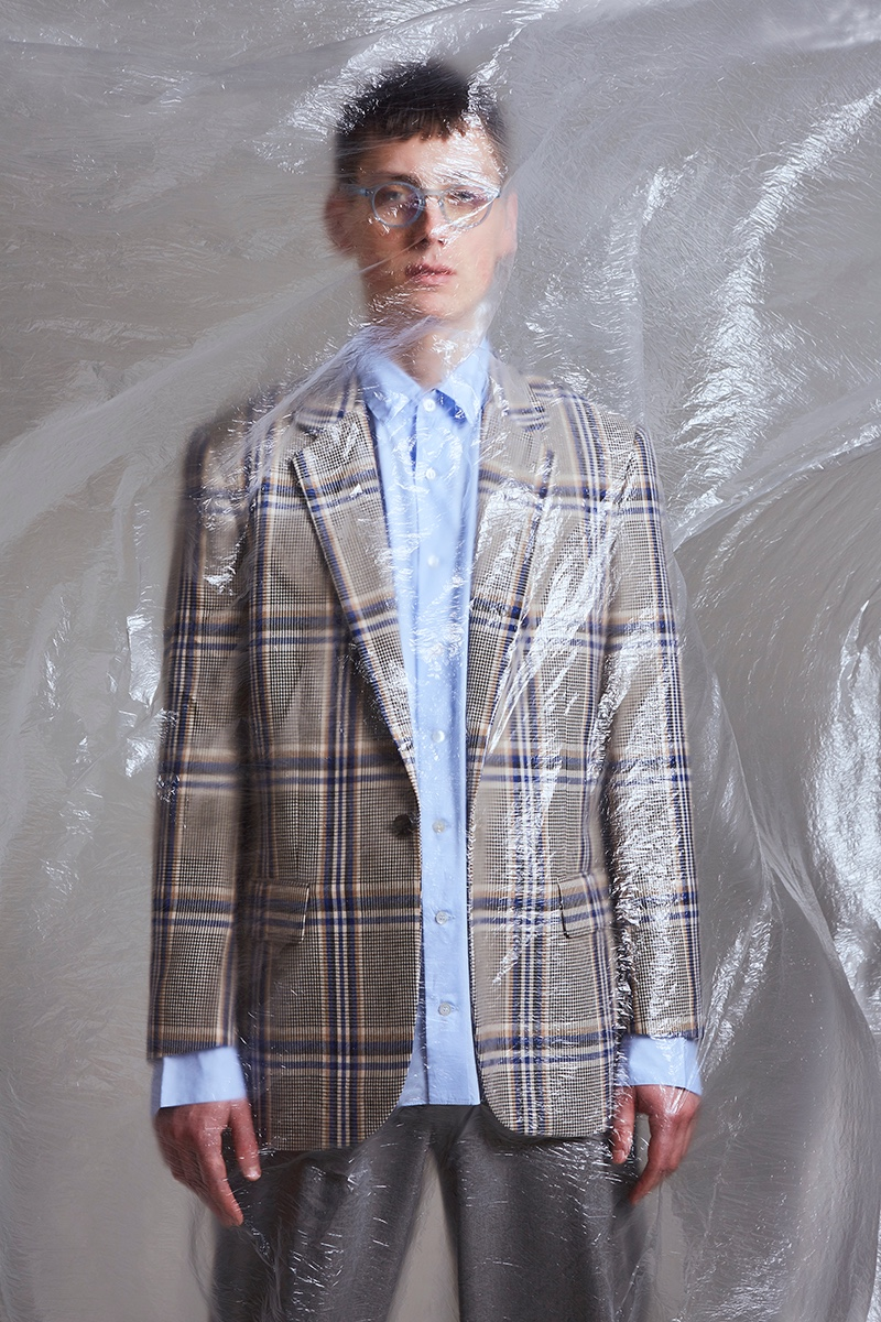 Hubert wears blazer Reserved, shirt Omen, trousers Zara, and glasses Izipizi.